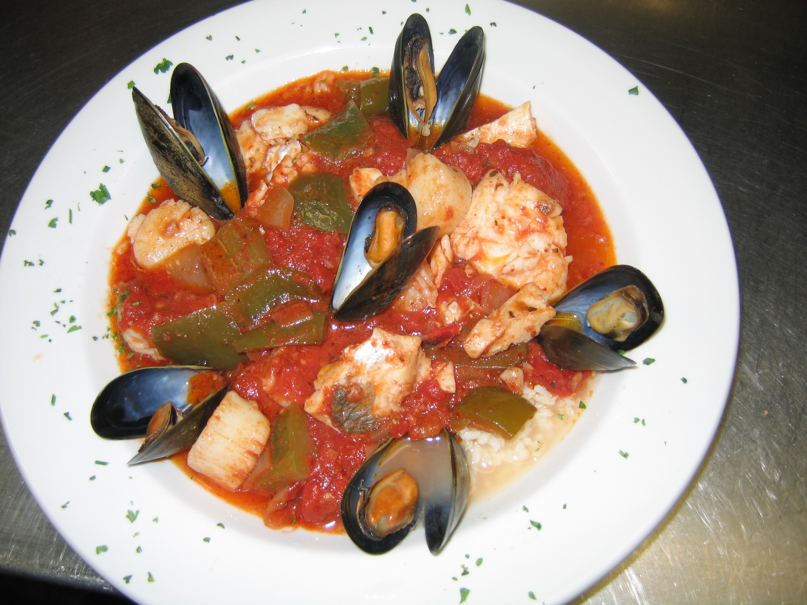 seafood cioppino shrimp scallops haddock and mussels simmered in a ...